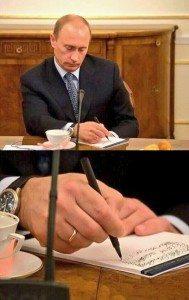حقيقة صورة بوتين و هو بيشخبط اثناء اجتماعة مع السيسي
