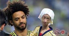 حقيقة لاعب فنربخشة التركي المسلم يحمل ابنته المعاقة