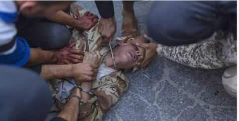 حقيقة صورة ذبح الجندي التركي