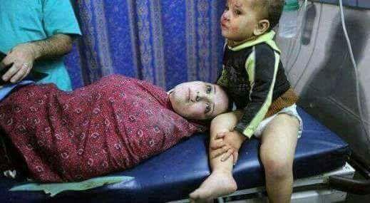 حقيقة صورة طفل بجوار أمه في تفجير الكنيسة البطرسية